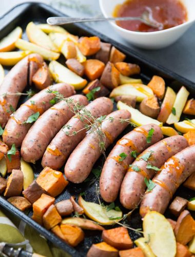 This sheet pan sausage dinner is inspired by the flavors of fall. Cheesy sausage is baked along side sweet potatoes, apples and a simple apricot glaze!