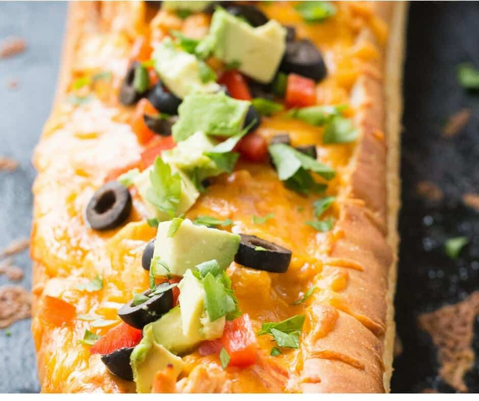 All the yummy flavors of chicken enchiladas are stuffed into a loaf of French bread! Dinner made simple!