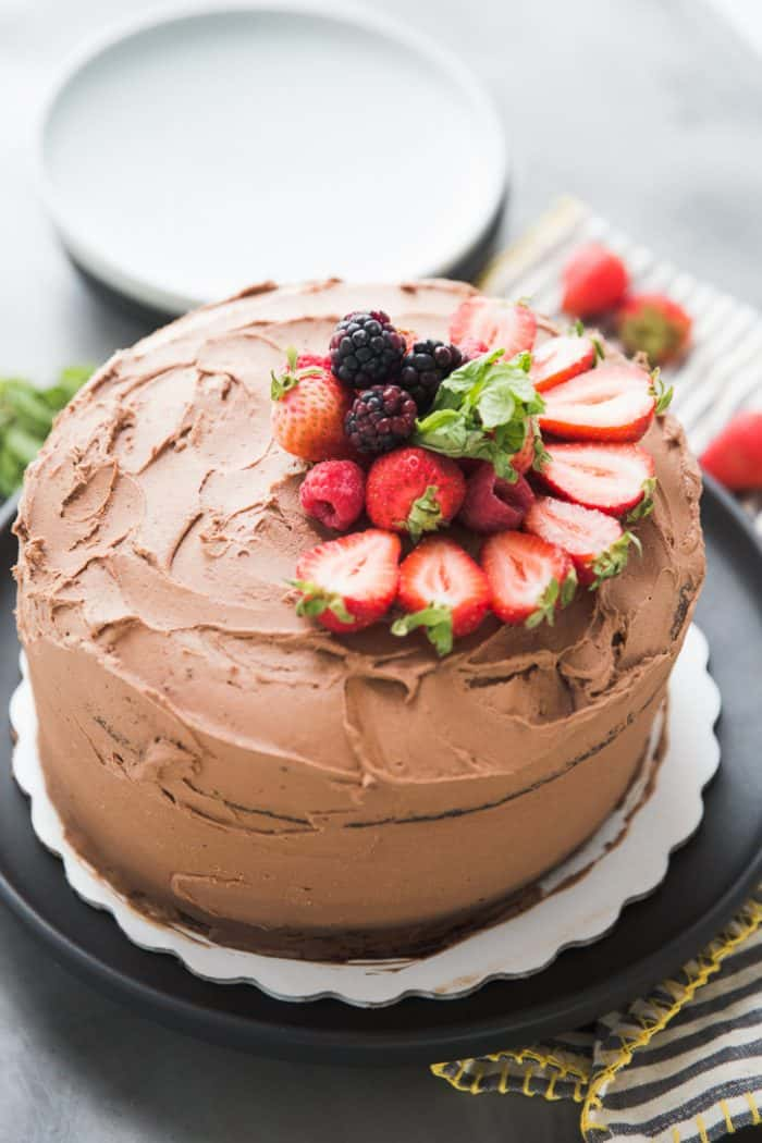 Whole chocolate cake with fruit