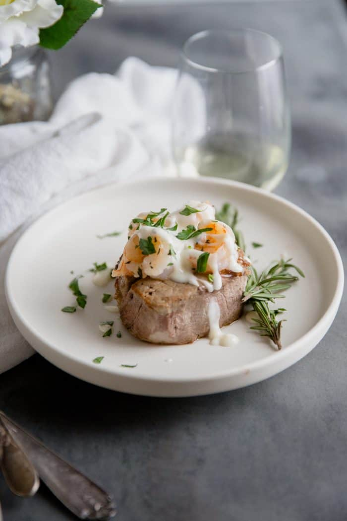 Steak with shrimp and topped with champagne sauce