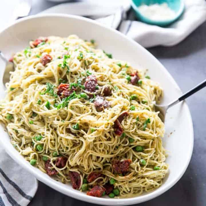 Pasta with peas on a platter side view