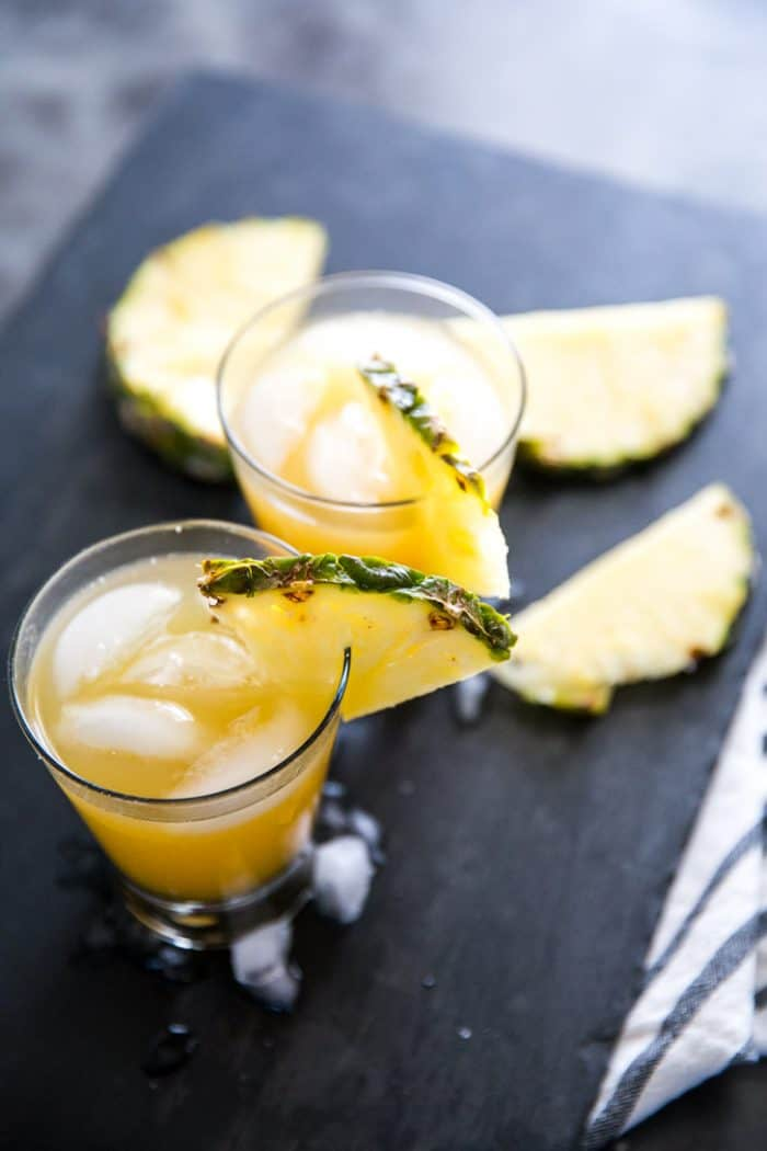 Vodka Cocktail two with pineapple slices surrounding
