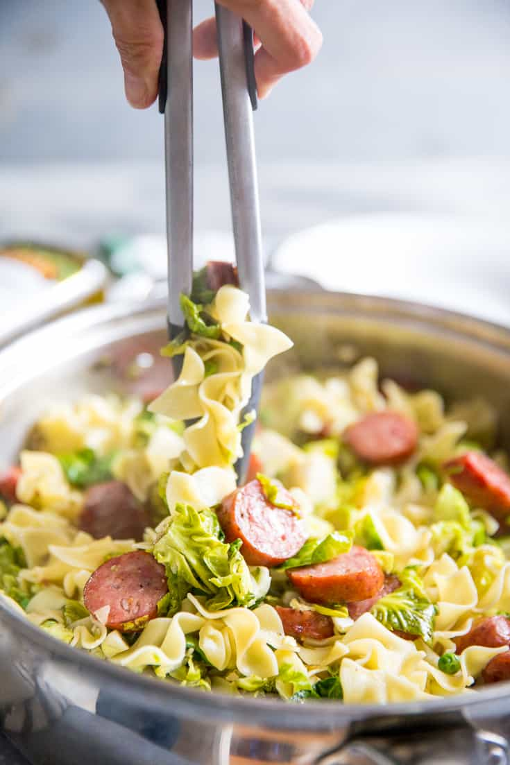 cabbage and noodles with tongs
