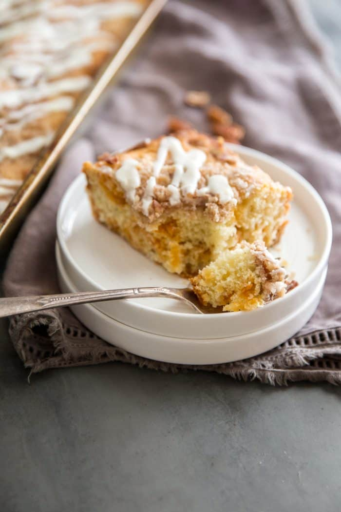 cinnamon coffee cake with a bite on a fork