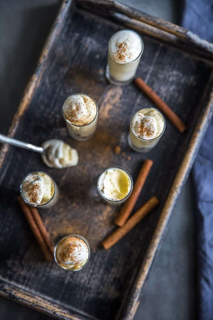 Pudding shots on a tray with a spoon