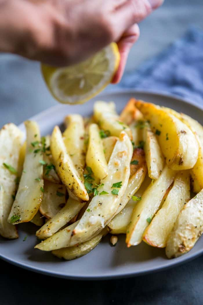 Greek roasted potatoes with a squeeze of lemon