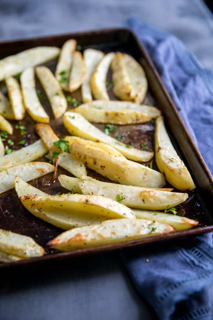 Greek roasted potatoes on a baking tray