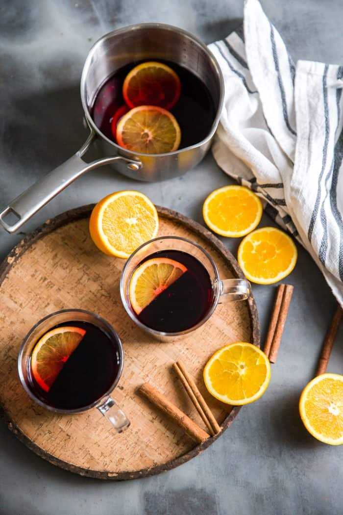 Warm red wine sangria two mugs and orange slices