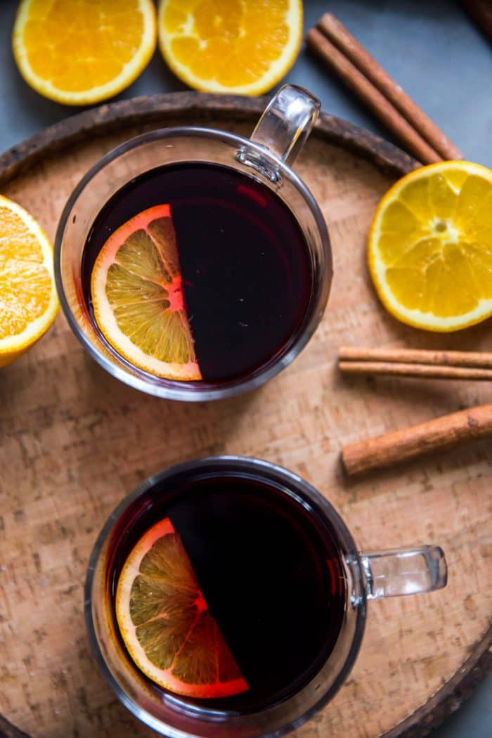 Warm red wine sangria two glasses with an orange slice