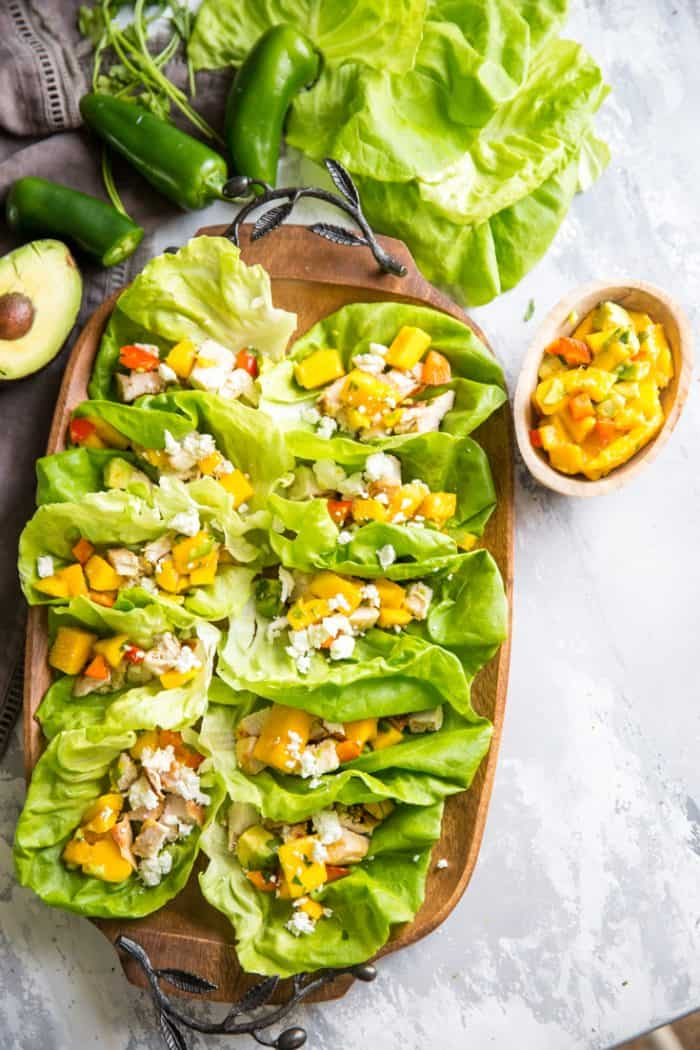 Grilled chicken wraps with mango salsa and goat cheese