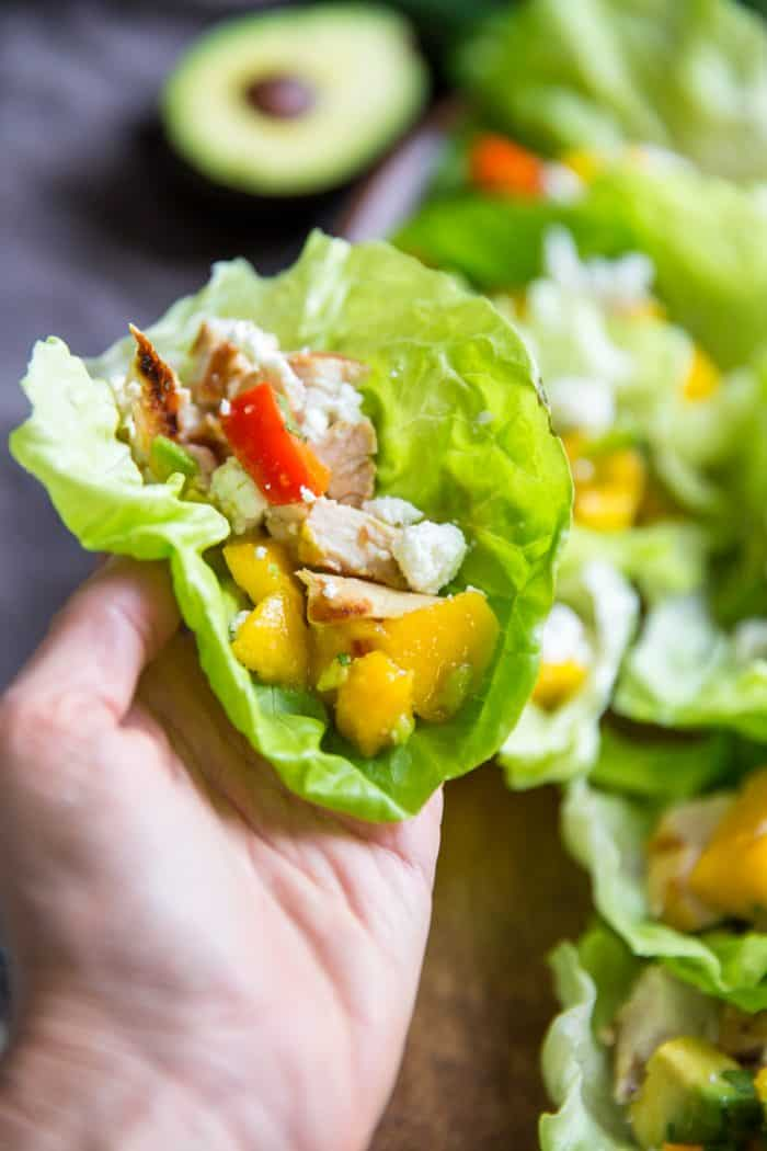 Hand with one chicken lettuce wrap