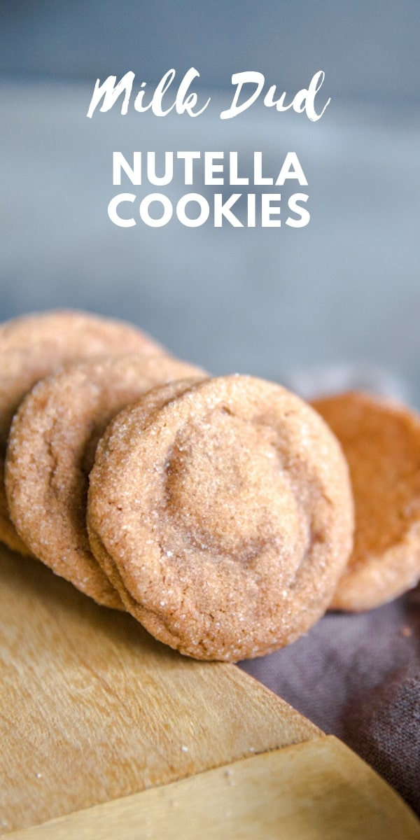 Soft, chewy Nutella Cookies have a surprise center...Milk Duds! The unlikely duo tastes so amazing together, you may find yourself making these cookies on a weekly basis!