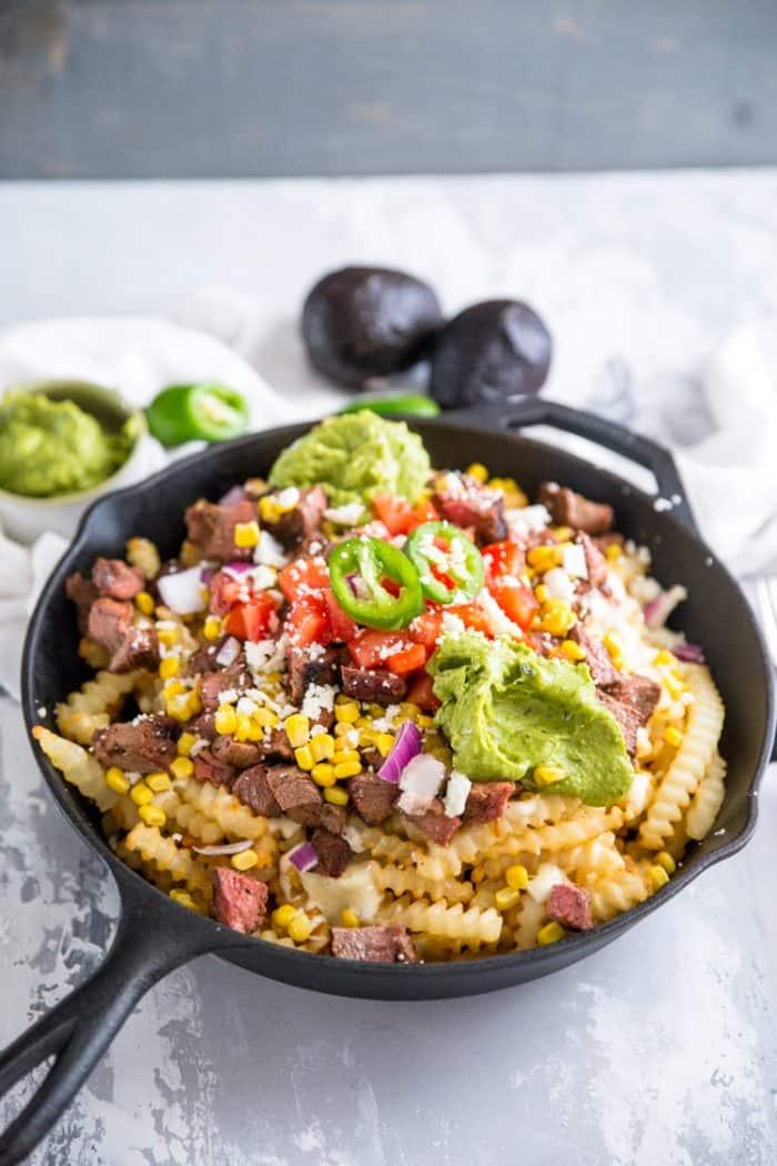 carne asada fries with avocados
