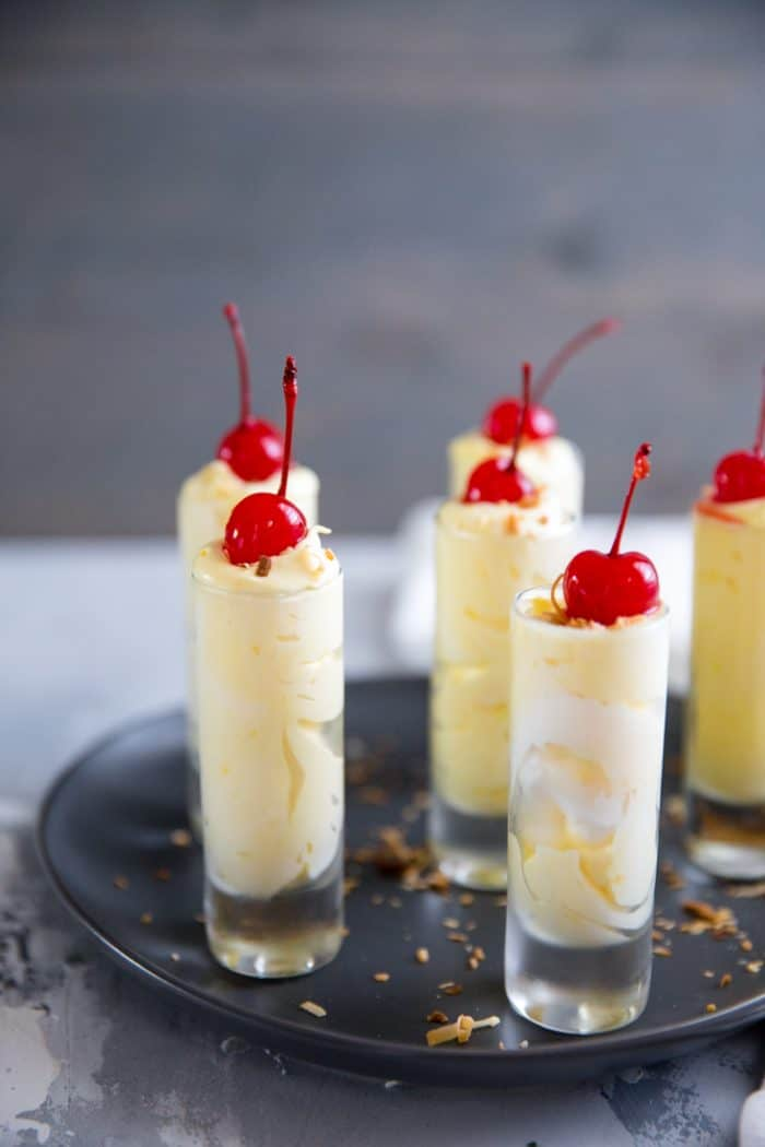 Pina colada pudding shots on a tray
