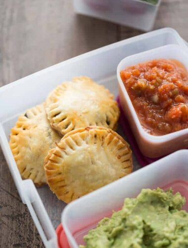 A box filled with different types of food and taco hand pies
