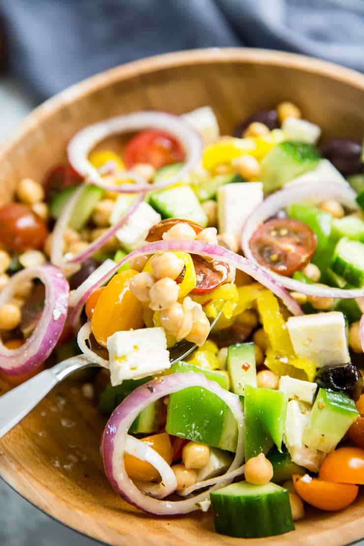 Greek salad with serving spoon