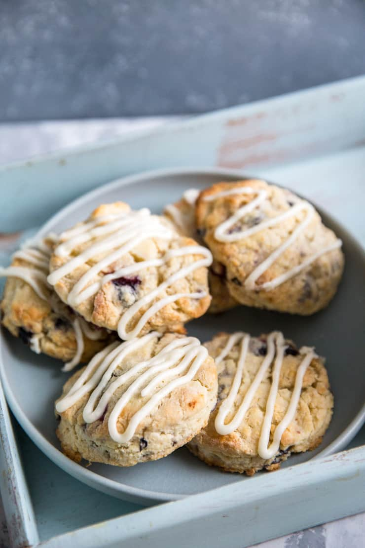 blueberry scones piled on a blue plate