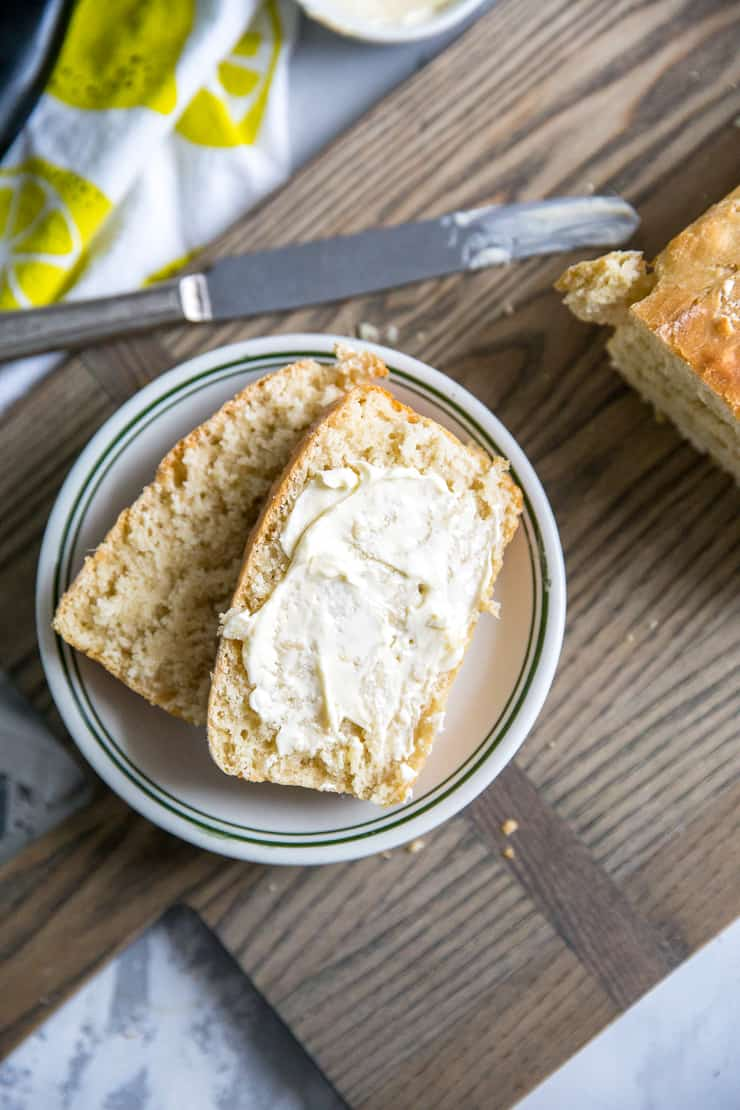 two homemade bread slices on a white plate