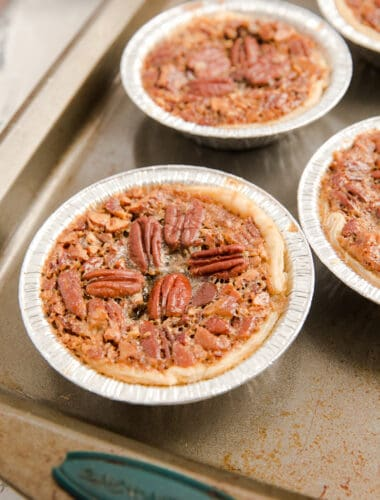 mini pecan pie in an aluminum tin